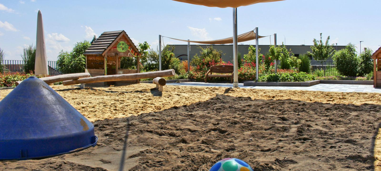Playground with sand on a roof
