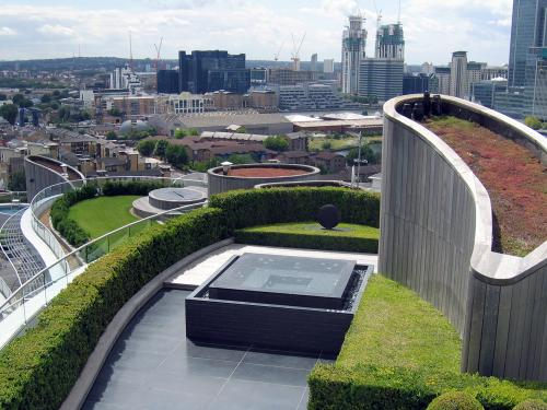 Roof terrace with modern fountain and Sedum roof