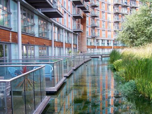 Water channel adjoining balconies of a residential building