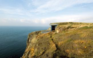 Building with green roof on a cliff